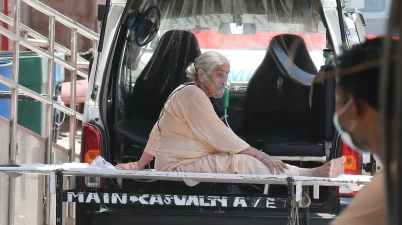 A patient in New Delhi is moved to designated COVID-19 hospital area. EPA